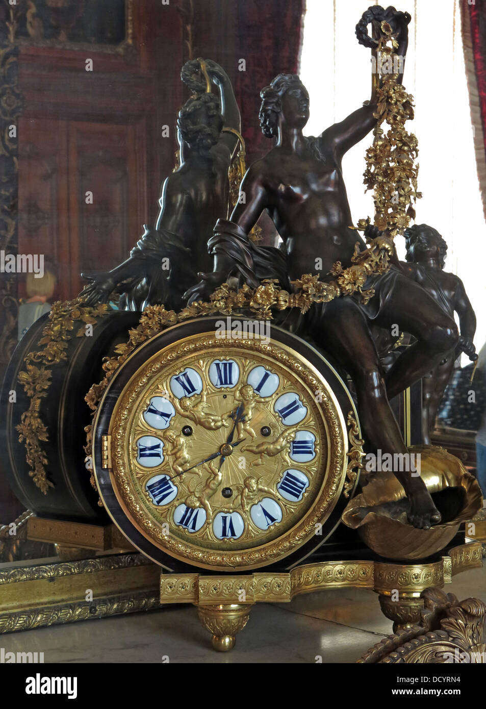 French style gold clock with black bronze statue - Stock Image