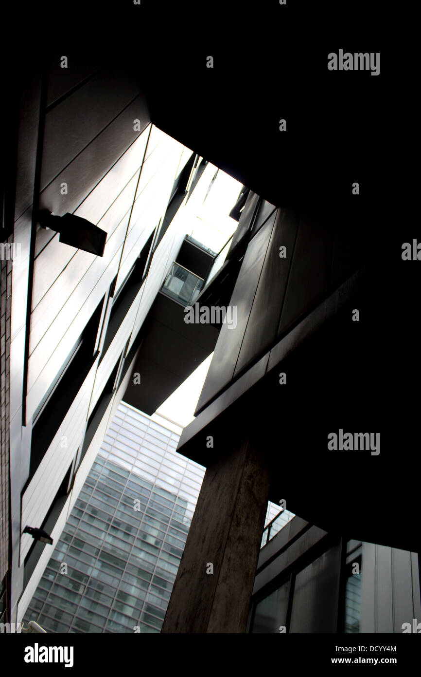 Modern Building Looking Upward with contrasts and shadows - Stock Image