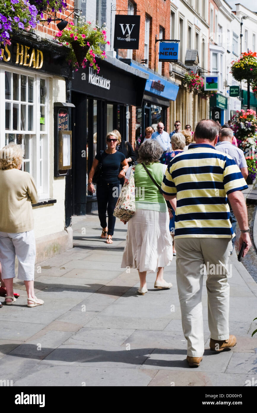 Shoppers out on the High Street in Wells, the smallest city in England. - Stock Image
