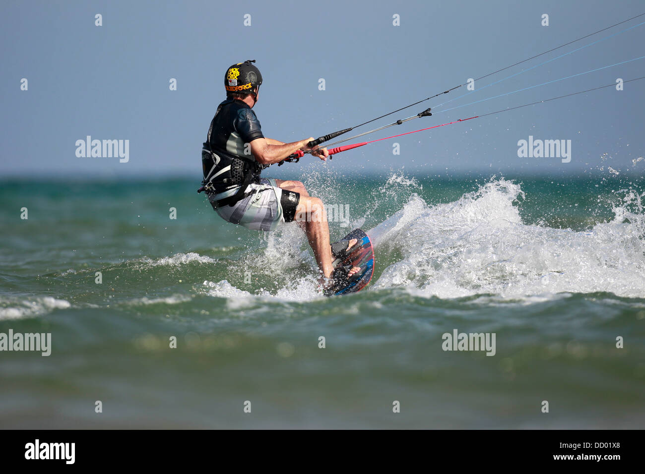 A kiteboarder heading offshore on a lake. Stock Photo