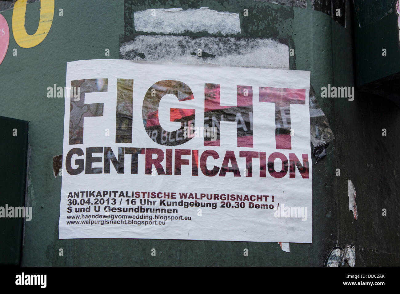 Flyer / sticker stuck on lamp post advertising protest march against gentrification and social exclusion Berlin - Stock Image