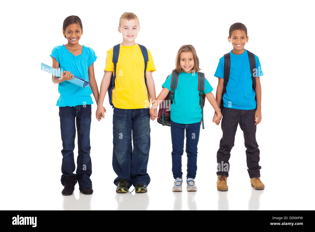 adorable elementary pupils holding hands isolated on white - Stock Image