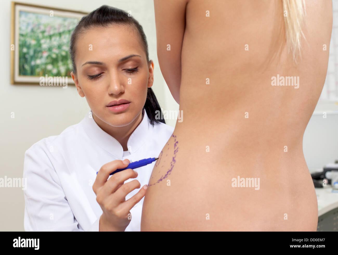Doctor plastic correction lines body - Stock Image