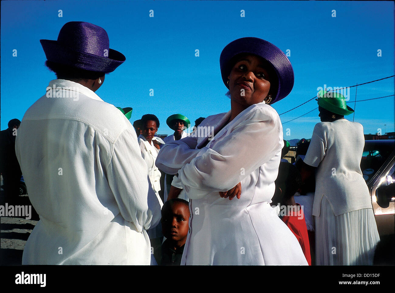 Apostolic Church choir members congregate outside prefabricated community hall after Sunday service Members this - Stock Image