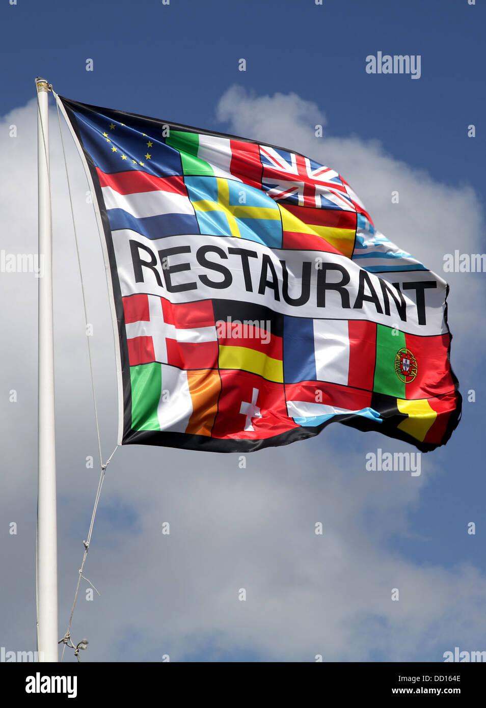 Restaurant flag.Restaurant banner.blue sky.European flag.EU.Europe. - Stock Image