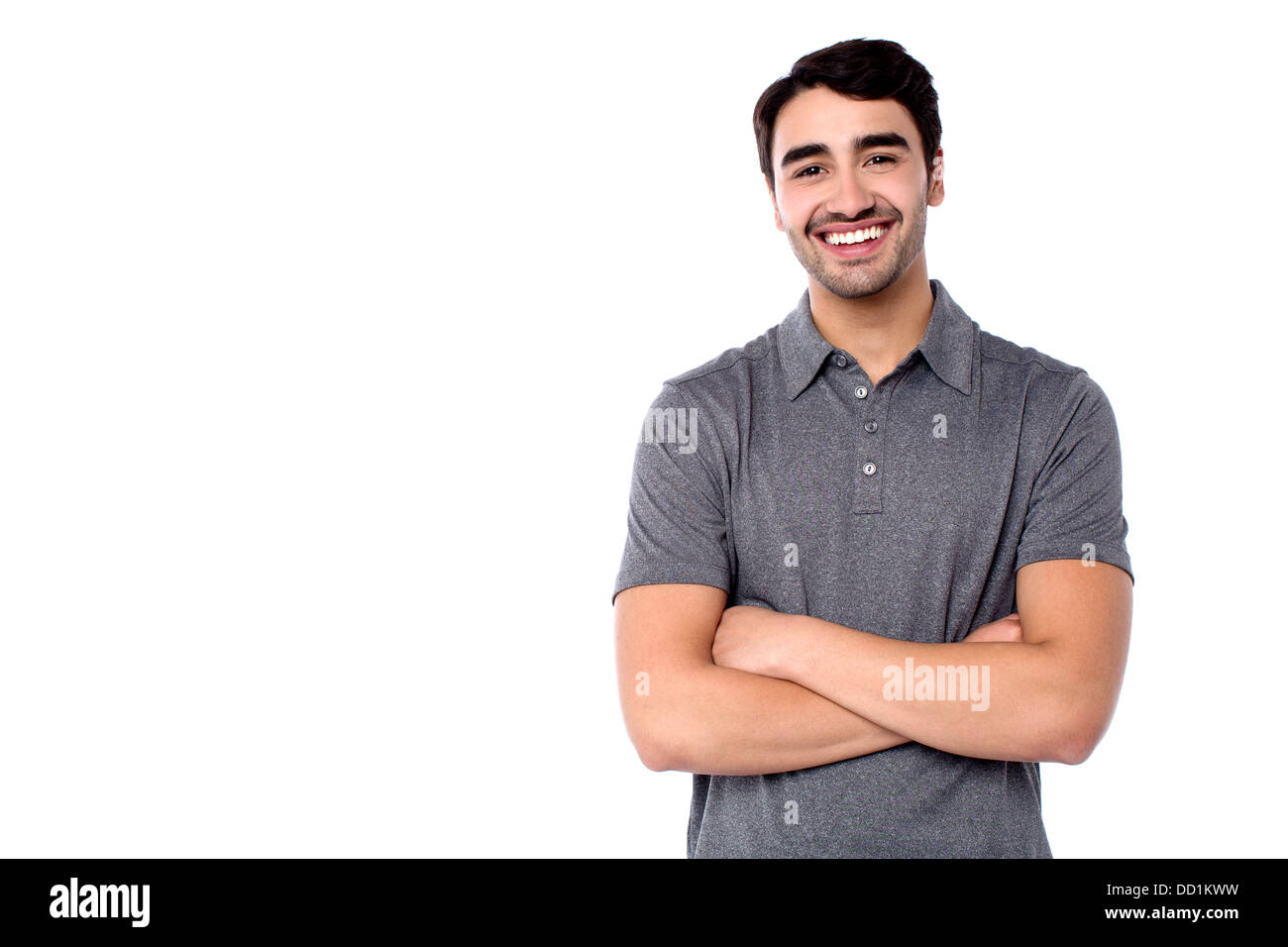 Half length portrait of smiling casual guy. - Stock Image