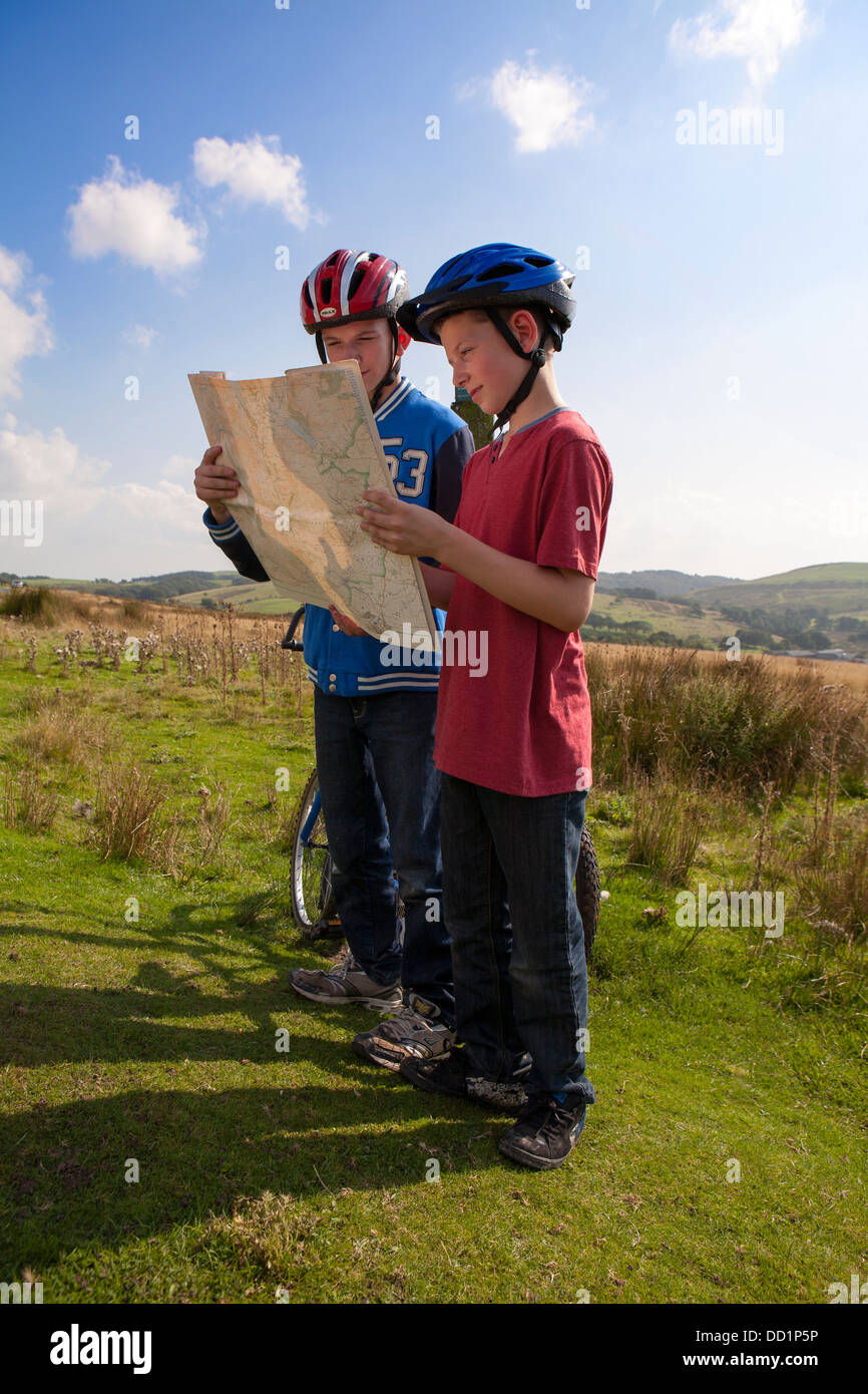 a map reading summer tourist boy outdoors trip hiking child kid male Stock  Photo - Alamy