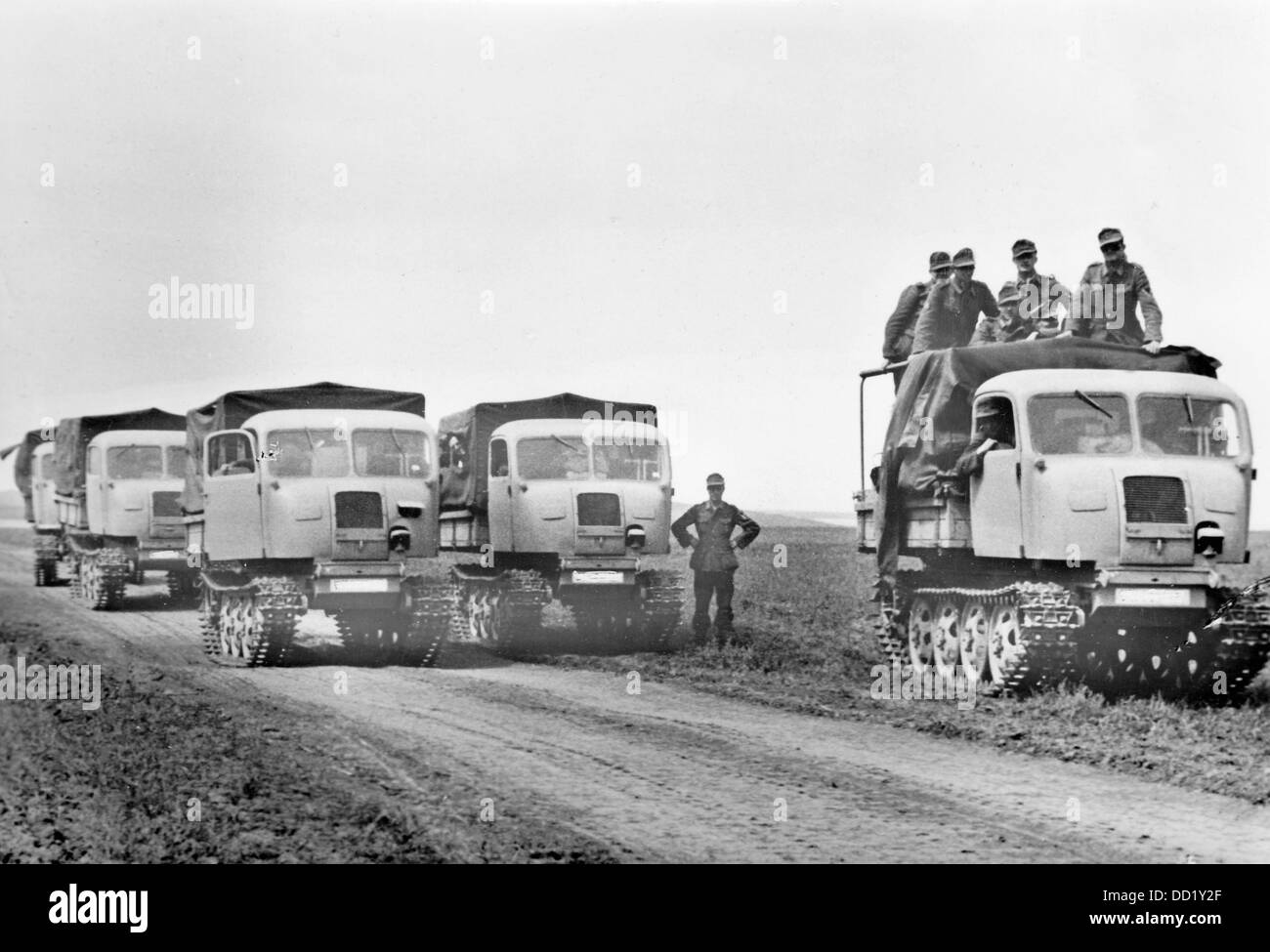"""The Nazi Propaganda! on the back of the image reads: """"New types of tractors for the Eastern Front. The industry Stock Photo"""