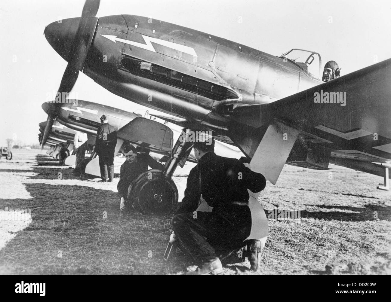 Members of the German Wehrmacht prepare fighters of the type Heinkel He 113 for the next air raid in April 1940. - Stock Image