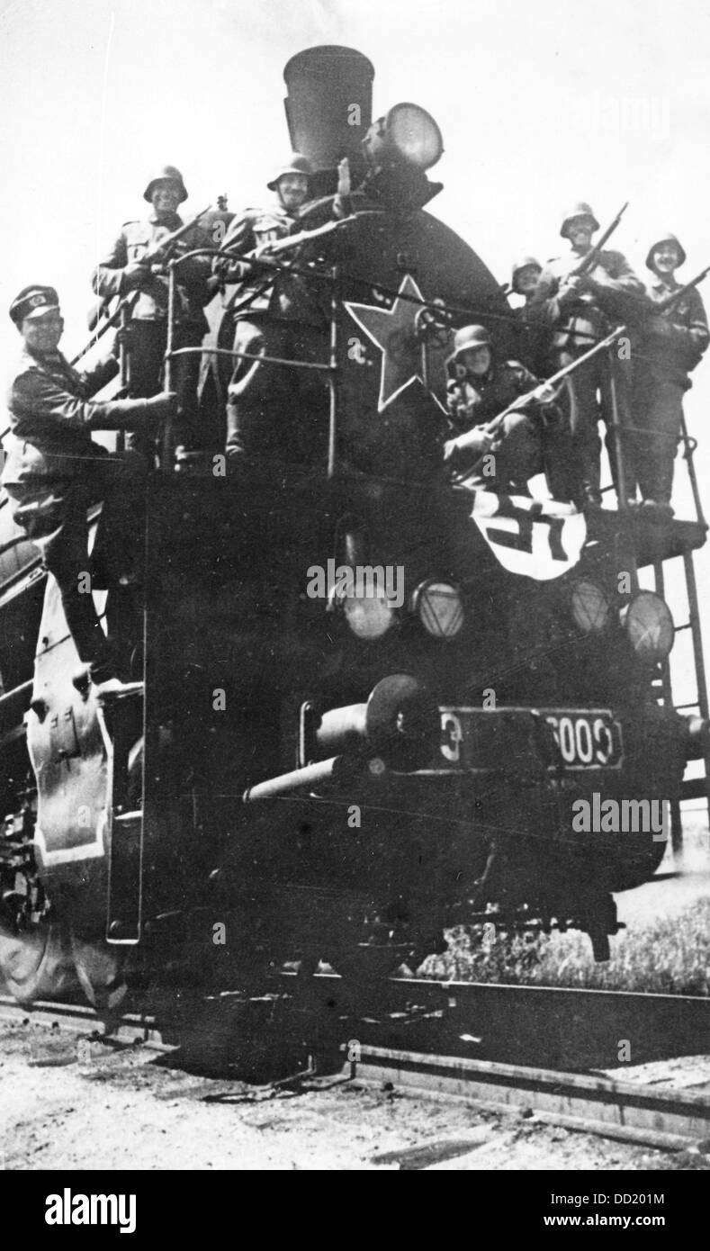 """The Nazi Propaganda! on the back of the image reads: """"Soviet trains run for us! A heavy transportation train decorated Stock Photo"""