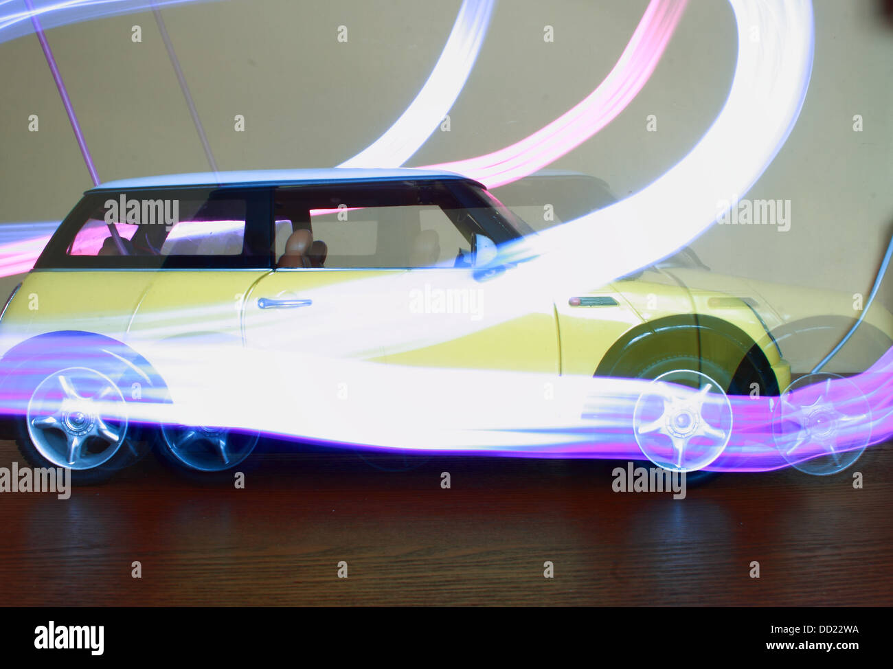 A toy car moving forward with motion lines using a torch - Stock Image