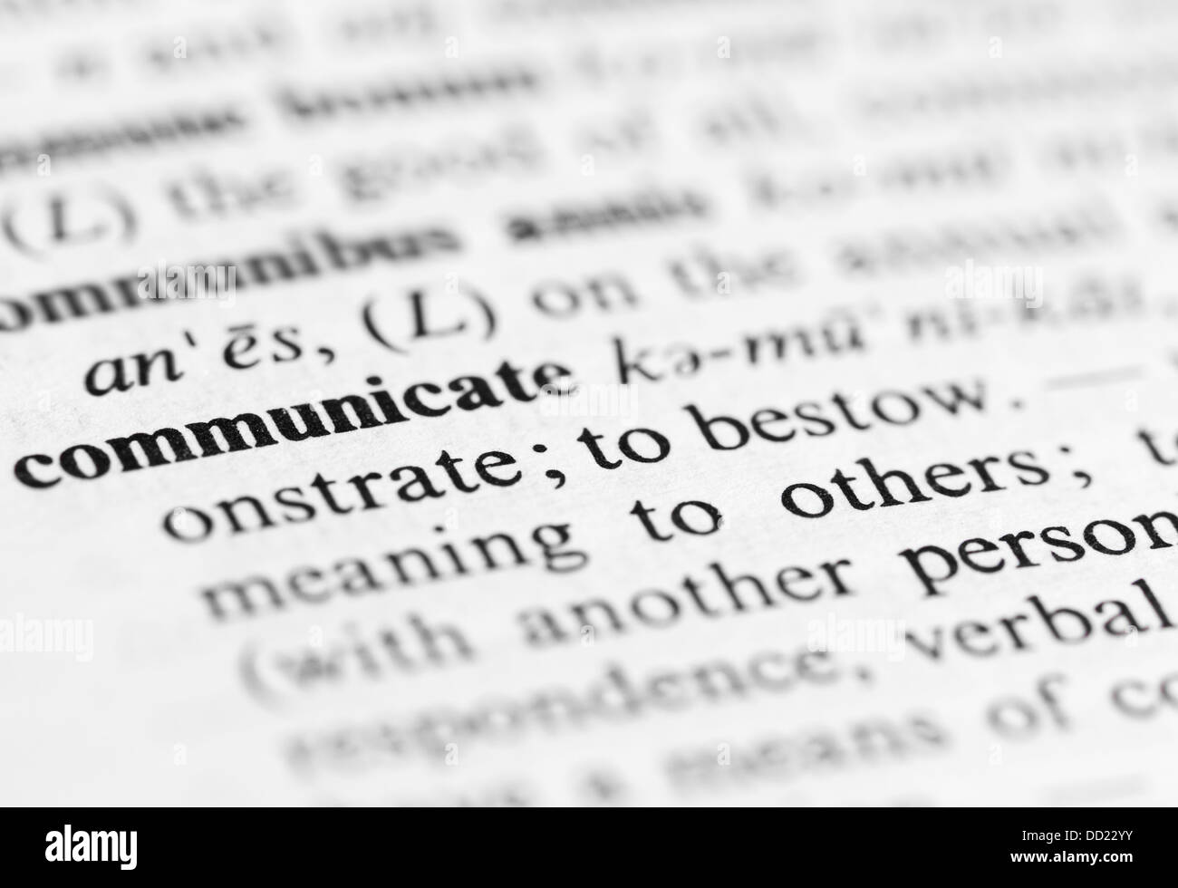 Close up of communicate definition - Stock Image