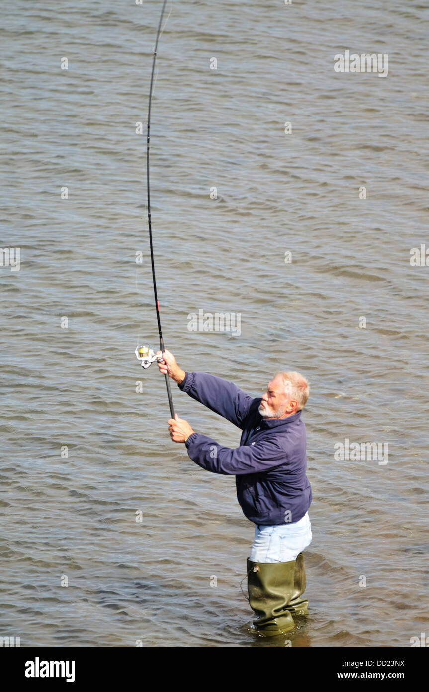 Fisherman casting his line in the River Teign near Teignmouth Stock Photo