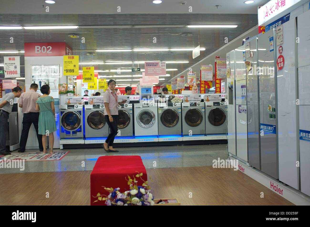 Haier washing machines and refrigerators are on sale in a Gome electrical appliances store in Beijing, China. 2013 Stock Photo