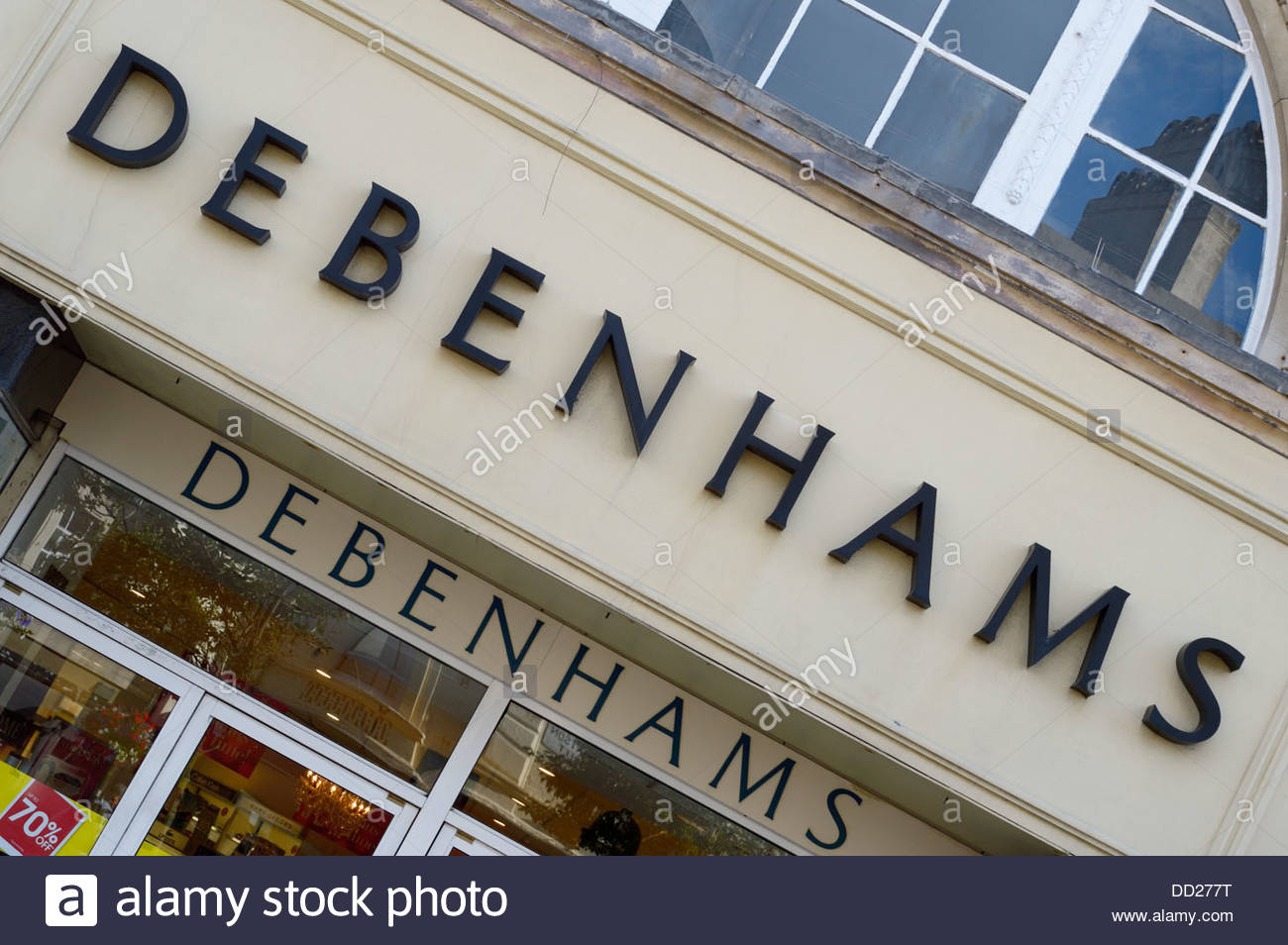 Debenhams sign above the shop doors in Hastings, East Sussex, England - Stock Image