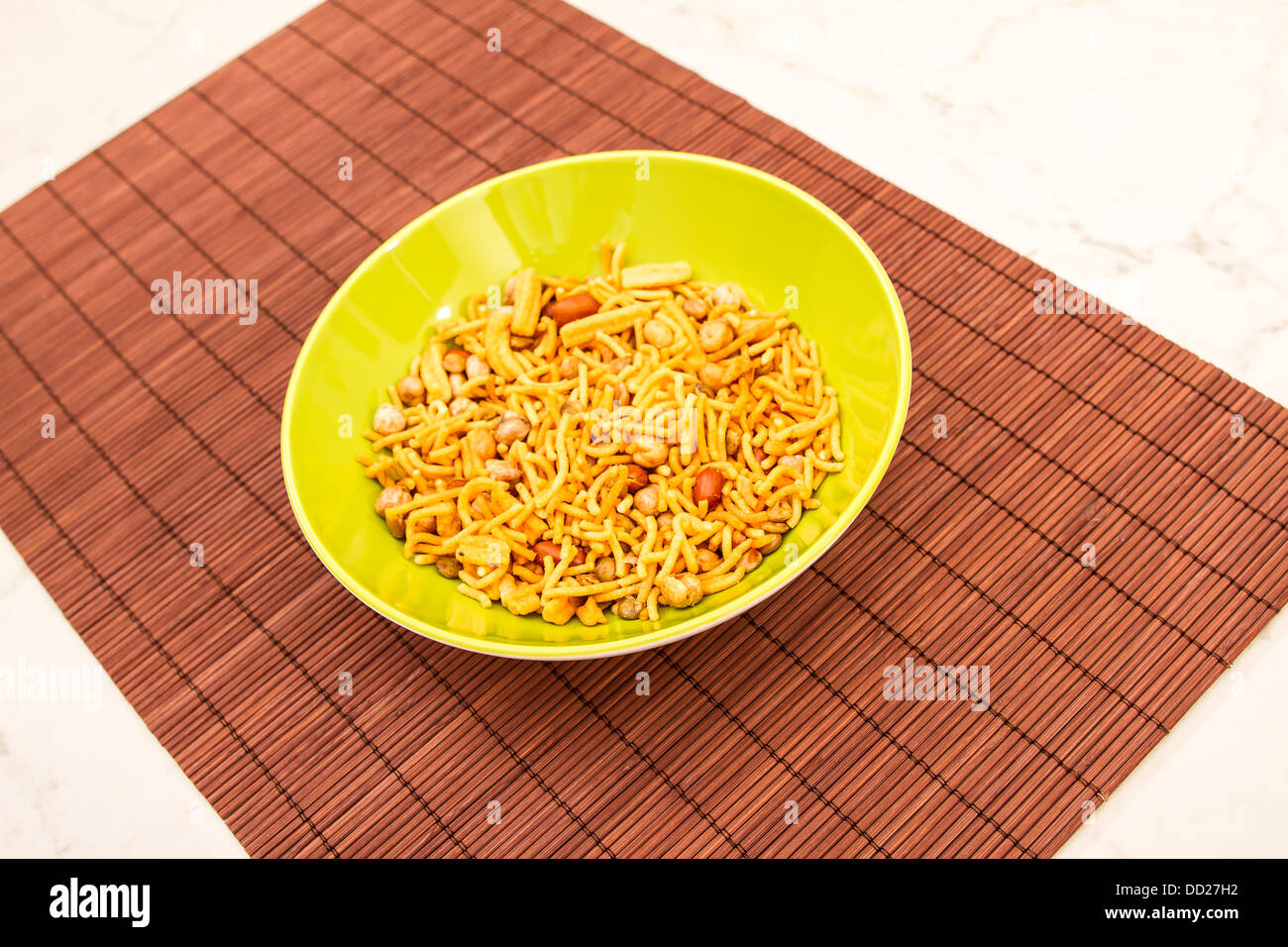 Snack Bombay Mix, a typical Indian snack - Stock Image