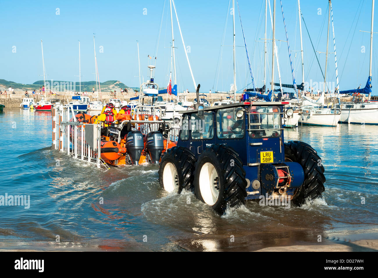 RNLI lifeboat launching on a training exercise at Lyme Regis harbour, Dorset, UK. Inshore inflatable rib lifeboat - Stock Image