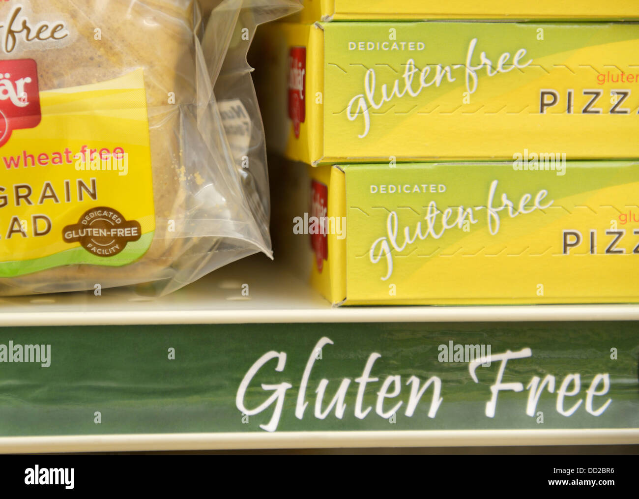 Gluten free food items on a shelf in the gluten free section of a supermarket - Stock Image