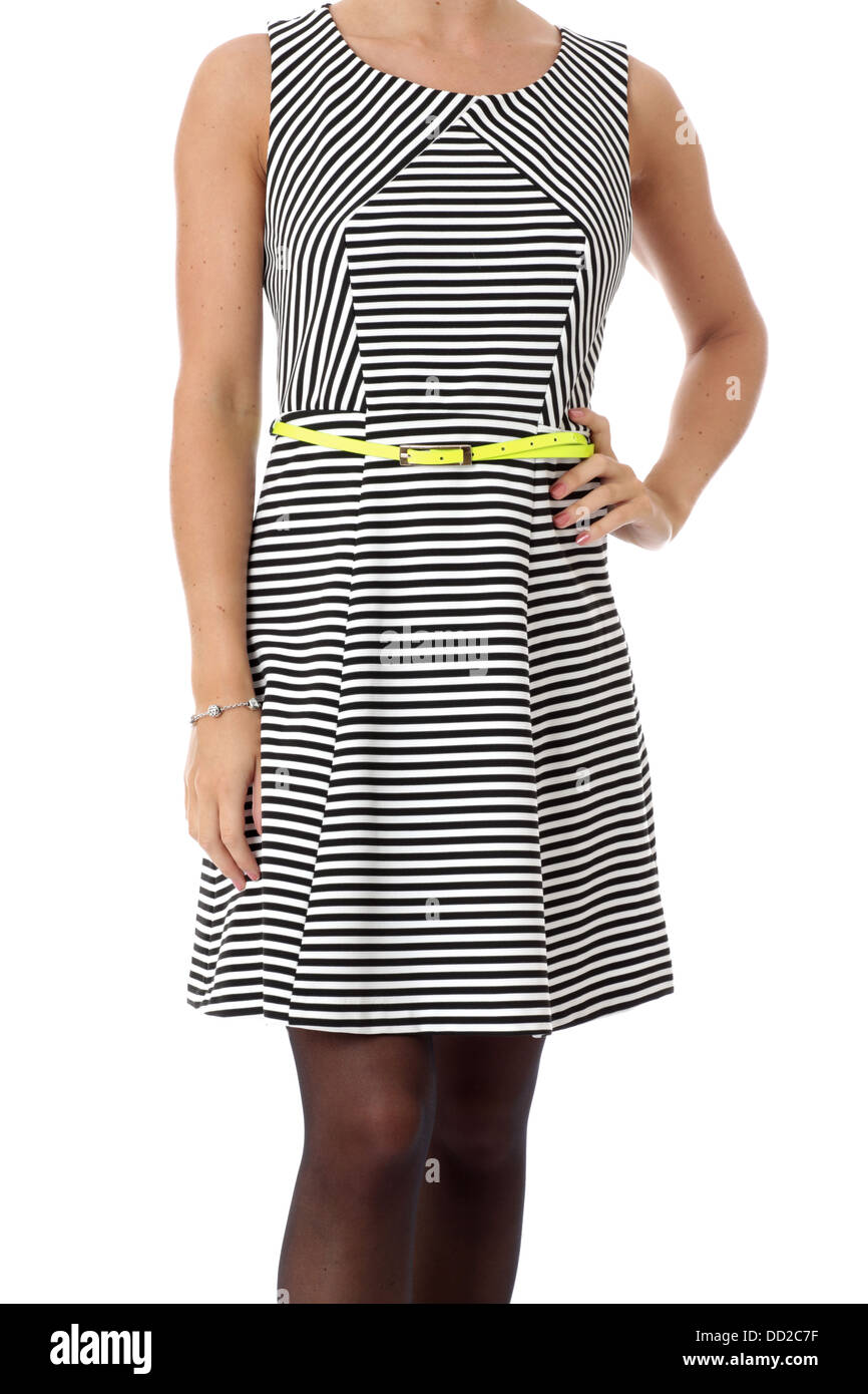 Model Released. Young Woman Modeling a Short Mini Dress - Stock Image