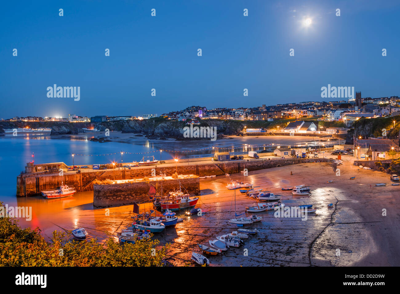 Full moon over the harbour and town at Newquay Cornwall England UK - Stock Image