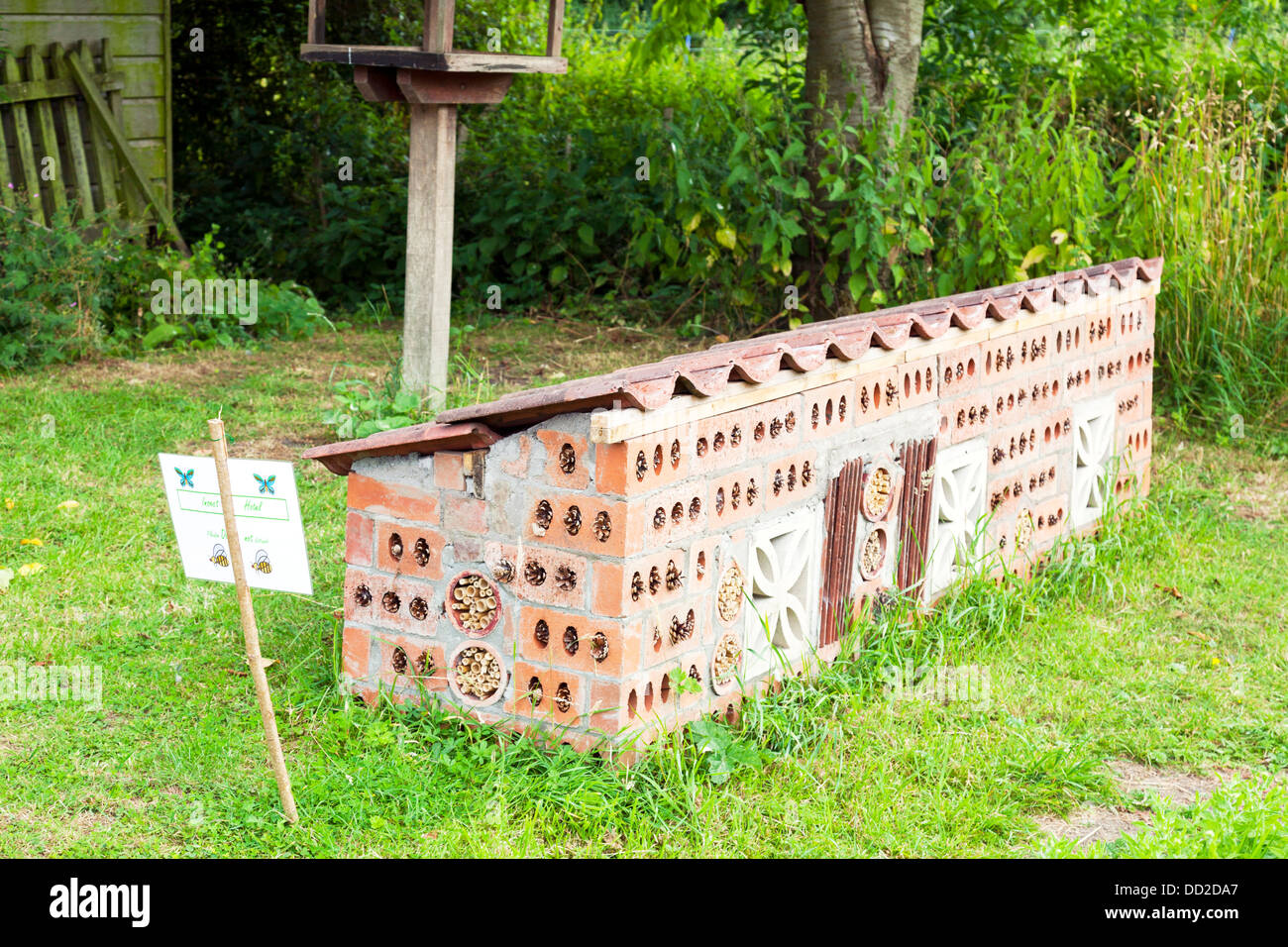 Purpose made insect hotel to harbor creepy crawlies and a place for them to call home and shelter - Stock Image