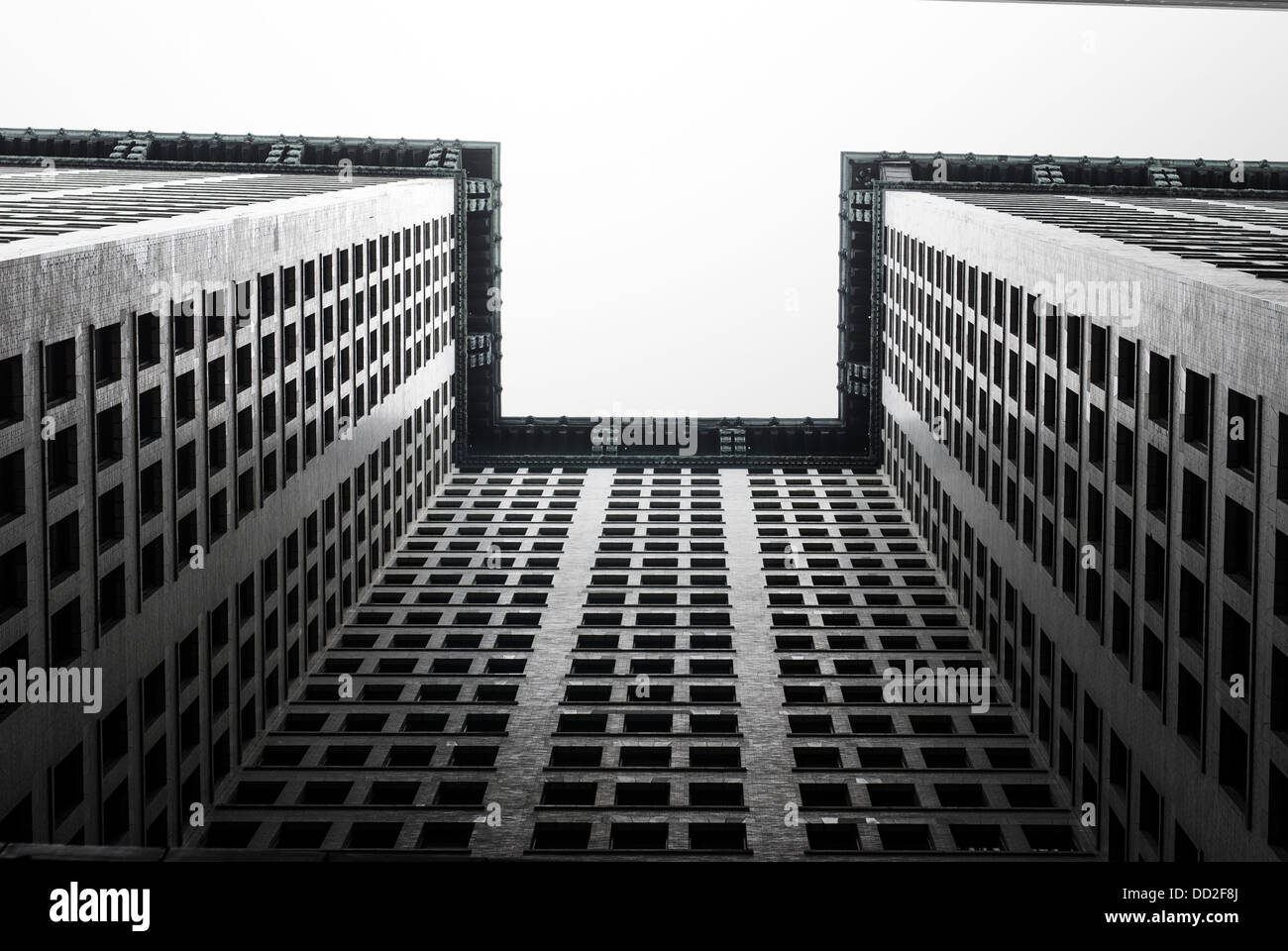 Sky scraper in Manhattan New-York city USA, seen from the bottom in May 2013. In Background a white sky. - Stock Image
