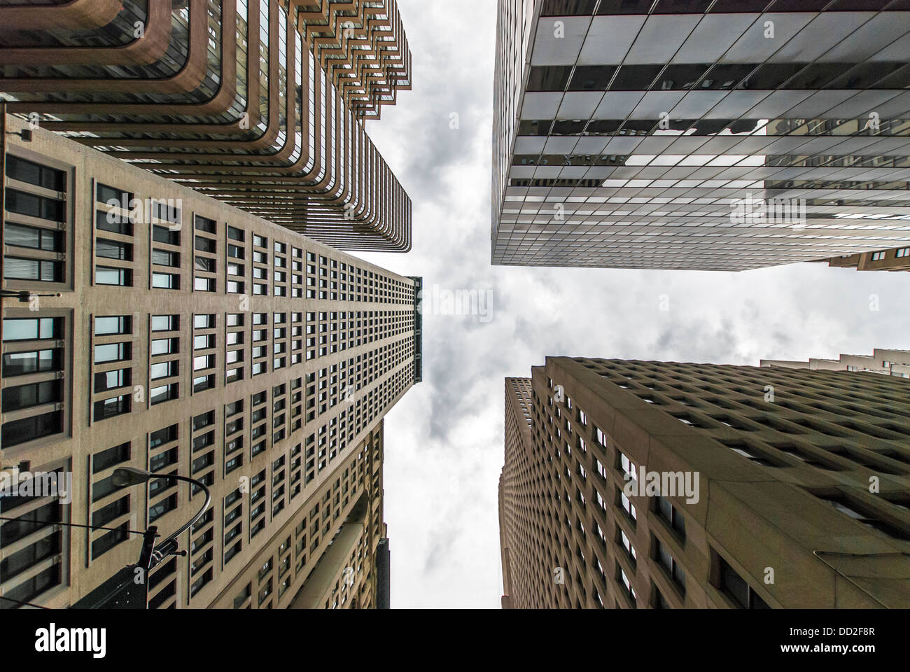 Sky scrapers in Manhattan New-York city USA, seen from the bottom in May 2013. In Background a cloudy sky. - Stock Image