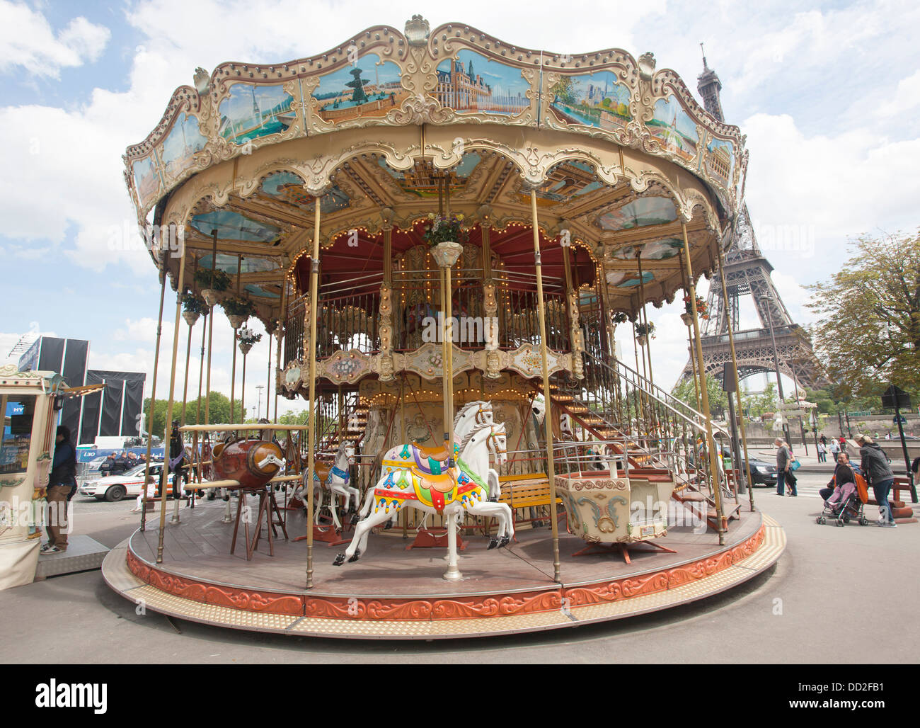 Old Fashioned French style Carousel near the Eiffel Tower in Paris France, also called a Merry-go-Round. - Stock Image