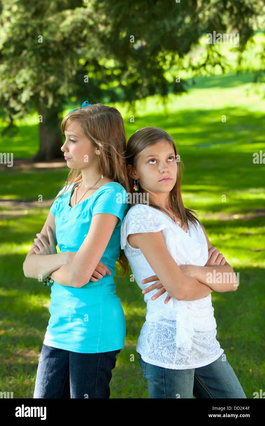 Two Sisters Disagreeing; Edmonton, Alberta, Canada Stock Photo