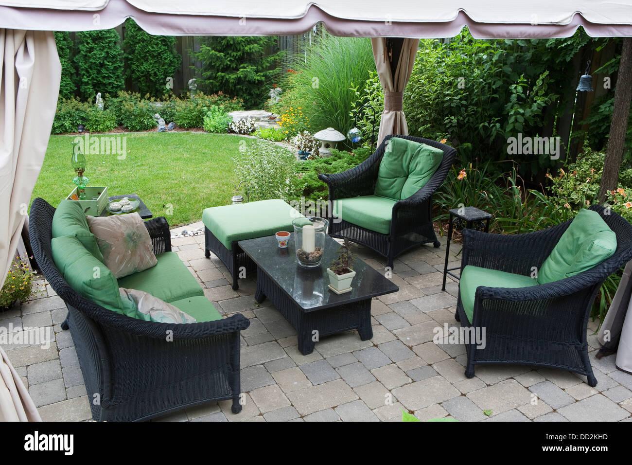 Covered Patio Furniture On Stone Patio In A Backyard Burlington Stock Photo Alamy