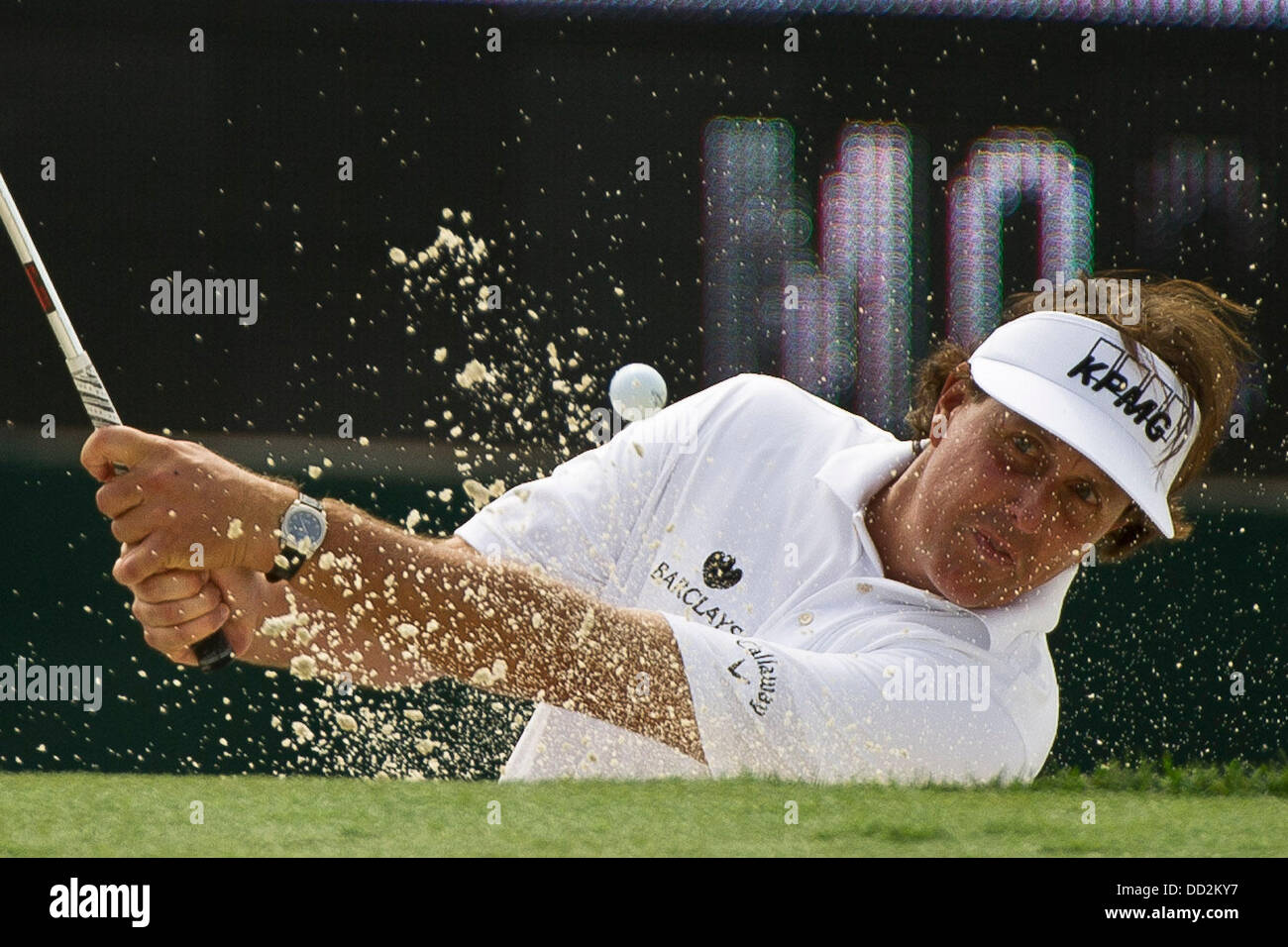Jersey City, New Jersey, USA. 23rd Aug, 2013. August 23, 2013: Phil Mickelson (USA) hits the ball out of a sandtrap - Stock Image