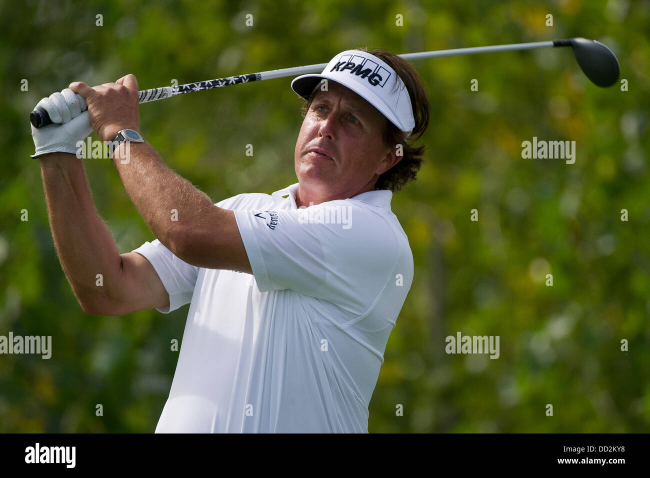 Jersey City, New Jersey, USA. 23rd Aug, 2013. August 23, 2013: Phil Mickelson (USA) tees-off and holds his club - Stock Image