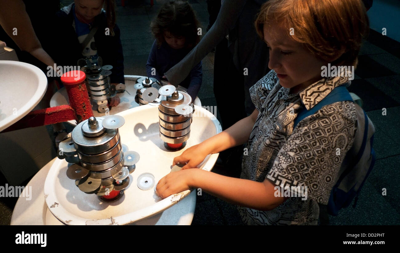 A boy playing with magnets at the Launch Pad in the London Science Museum interior South Kensington  England UK - Stock Image