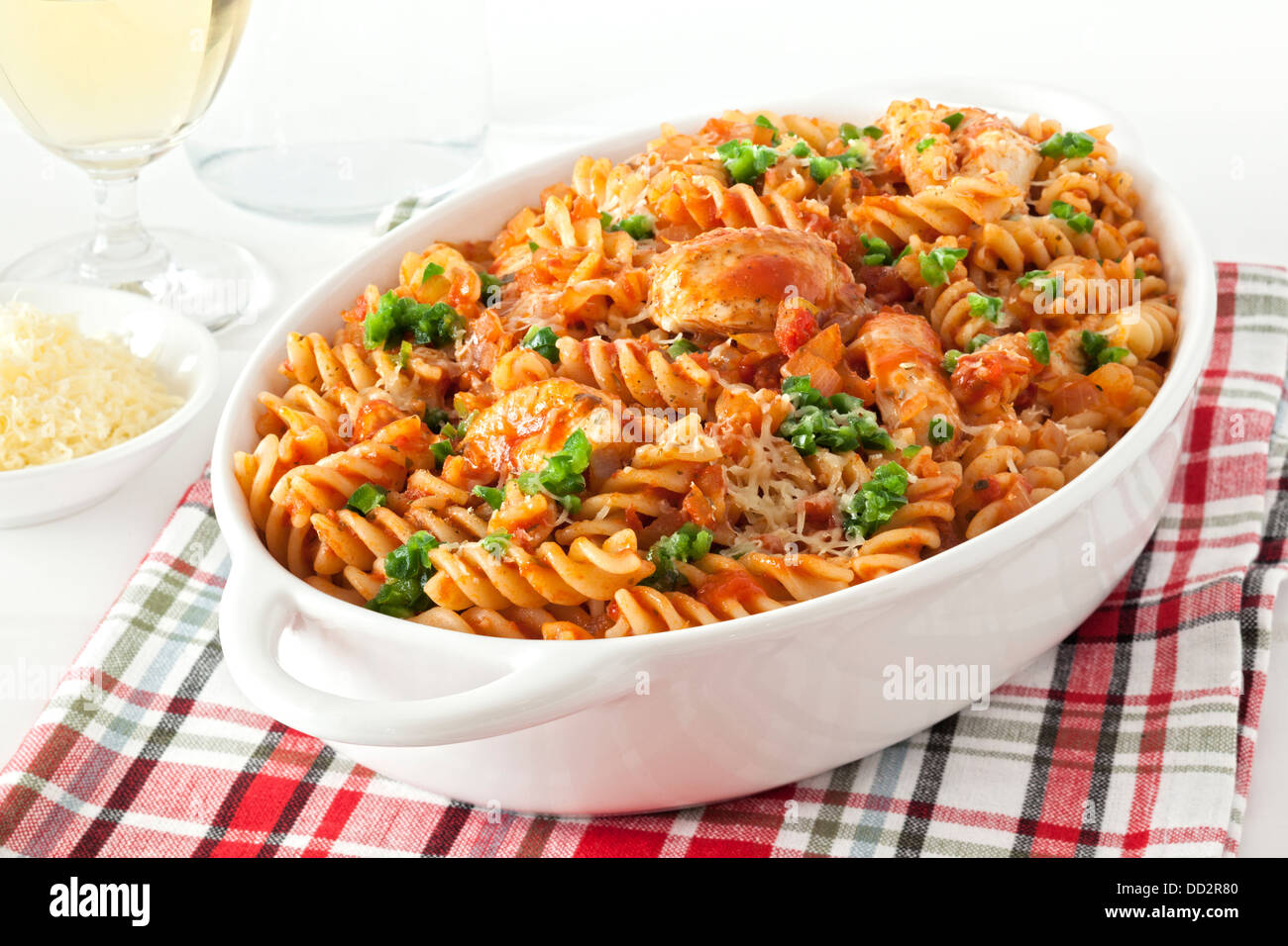Pasta Bake with Chicken - fusili or spiral pasta, baked with chicken and marinara, topped with green chilli and Stock Photo