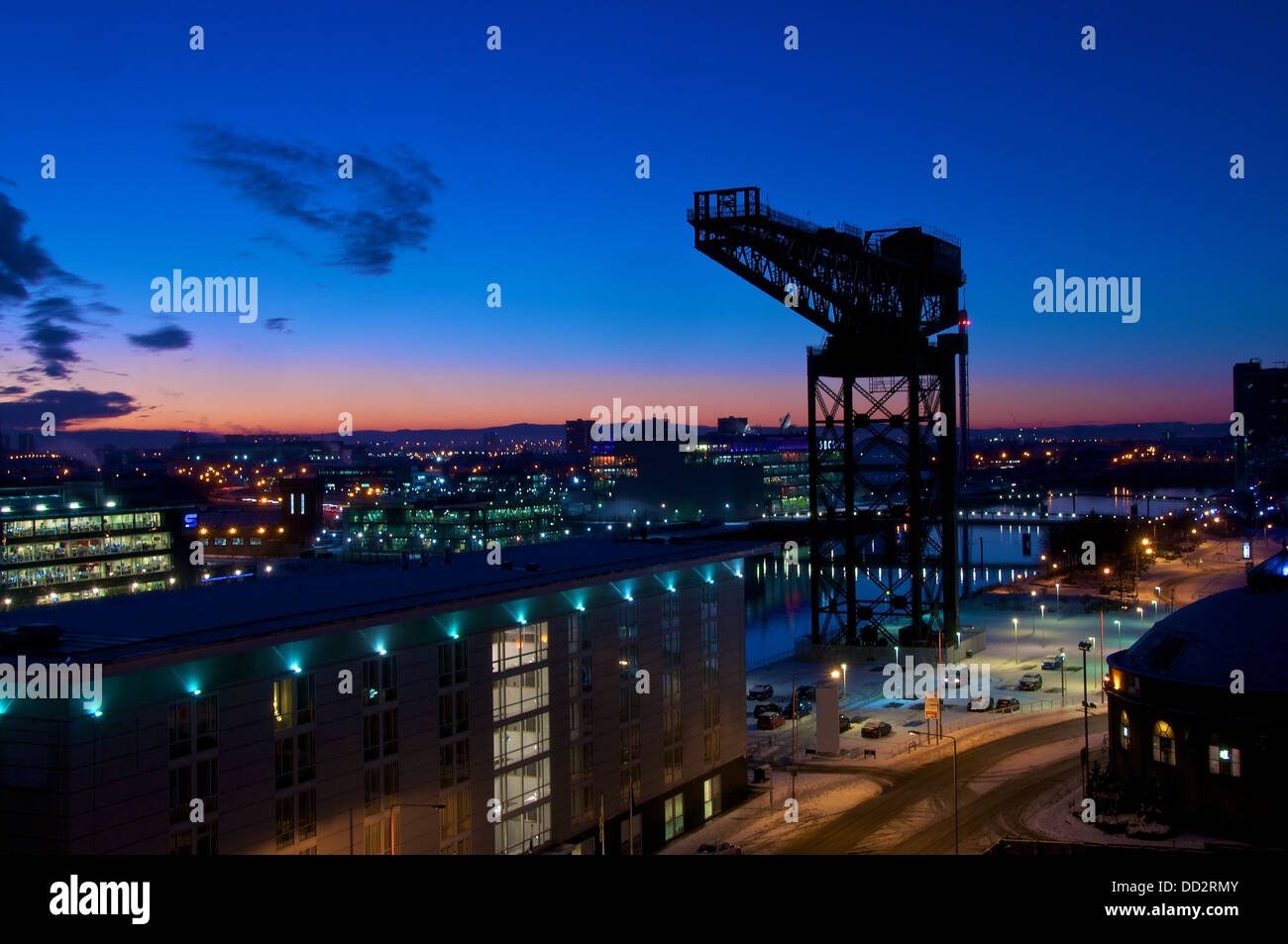 The Finnieston Crane sitting on the banks of the river Clyde is a landmark in Glasgow, Scotland - Stock Image
