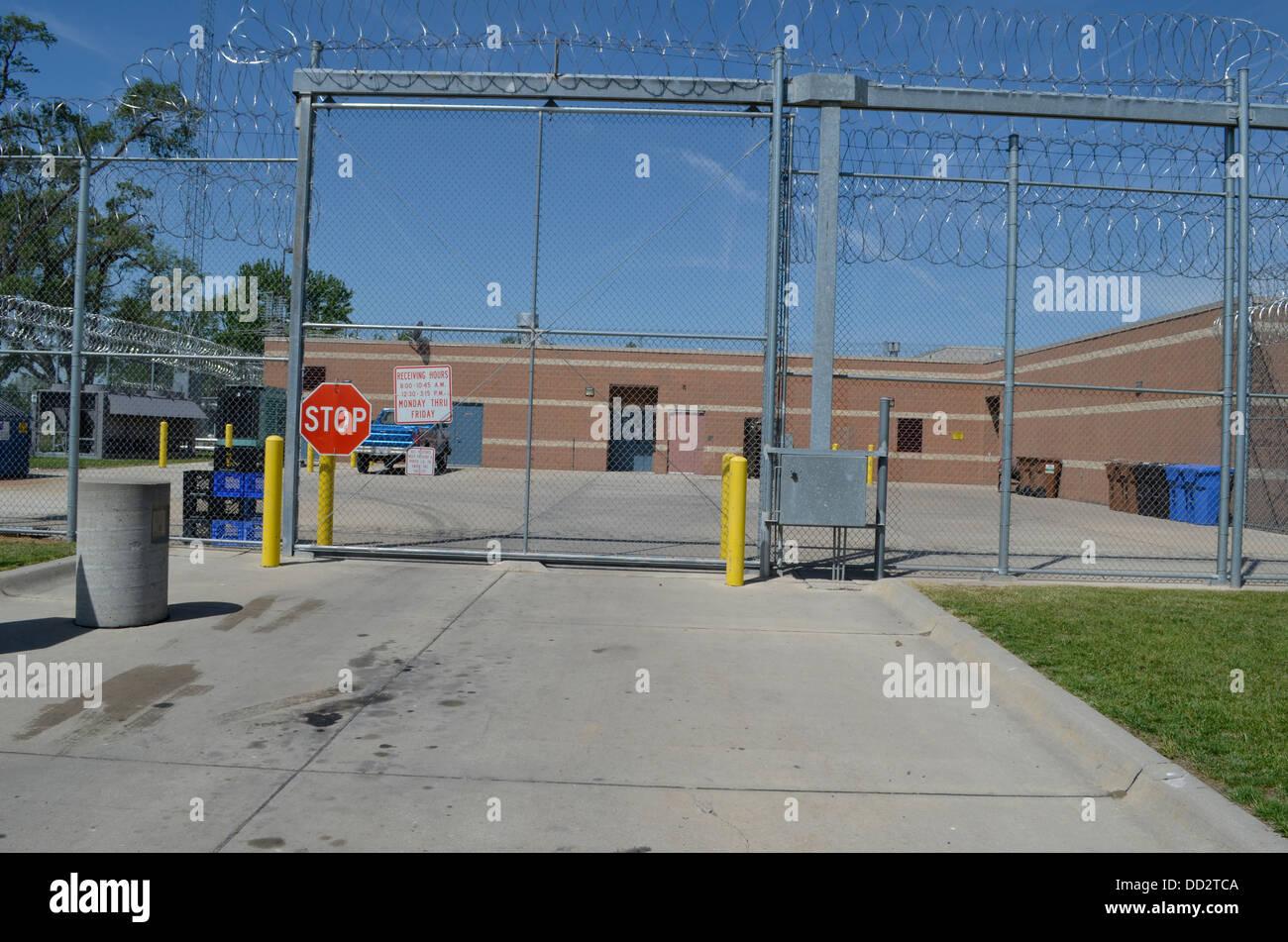 Perimeter fence at maximum security prison for juveniles in Omaha Nebraska. - Stock Image