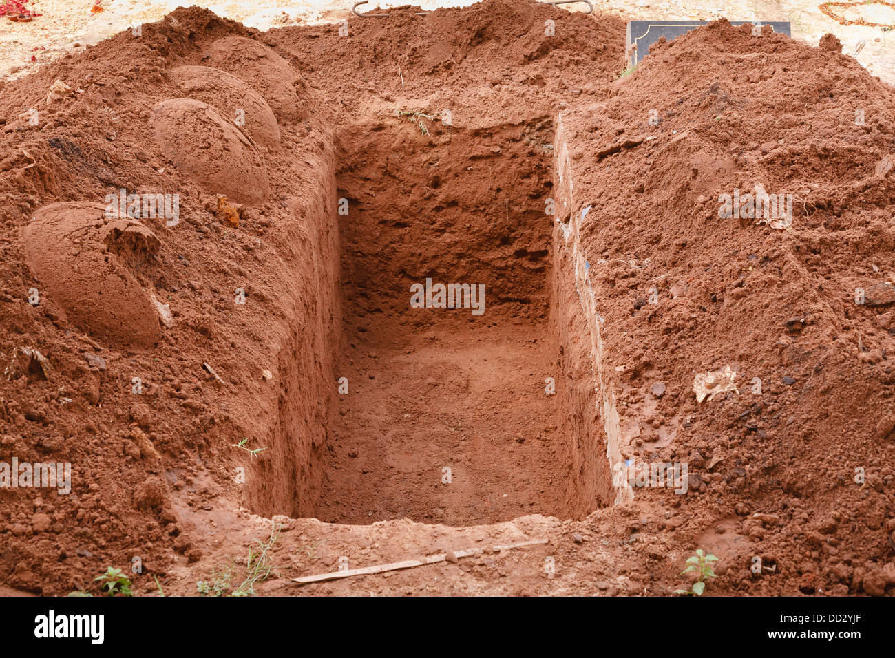 Open grave freshly dug for a burial - Stock Image