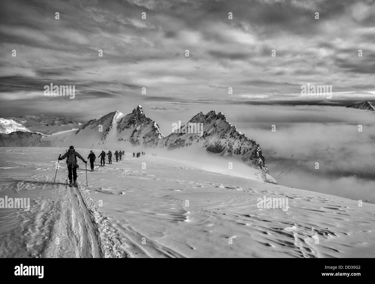 Skiers on the Haute Route in Switzerland Stock Photo
