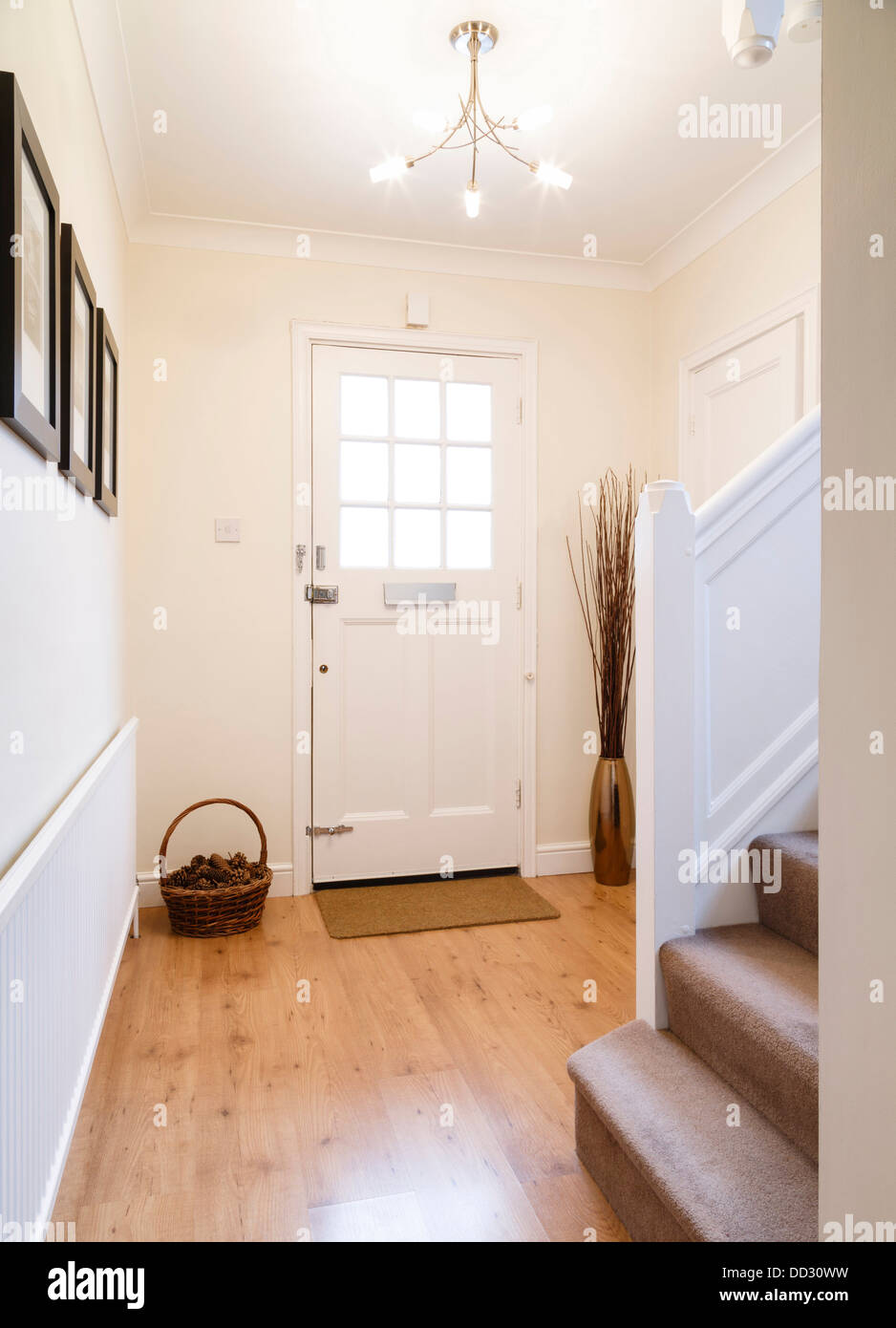 Modern hallway with a wooden floor and radiator - Stock Image