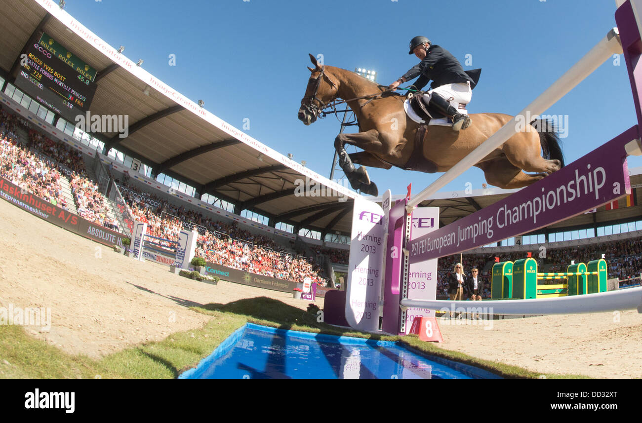 Herning, Denmark. 24th Aug, 2013. French show jumper Roger Yves Bost jumps over an obstacle on his horse Castle - Stock Image