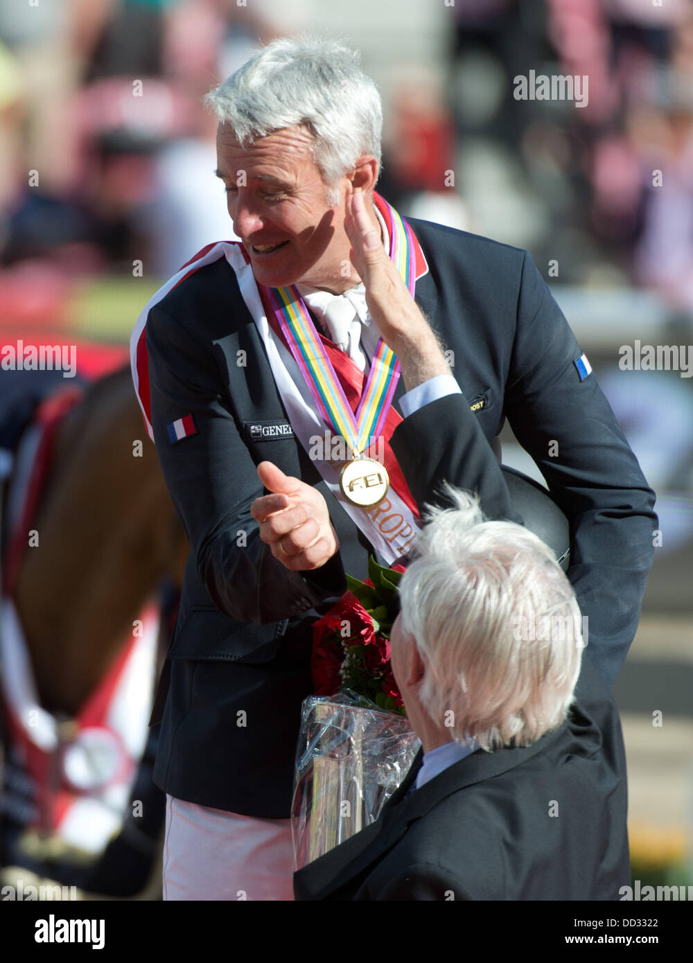 Herning, Denmark. 24th Aug, 2013. Winner French show jumper Roger Yves Bost shakes hands with former German show - Stock Image