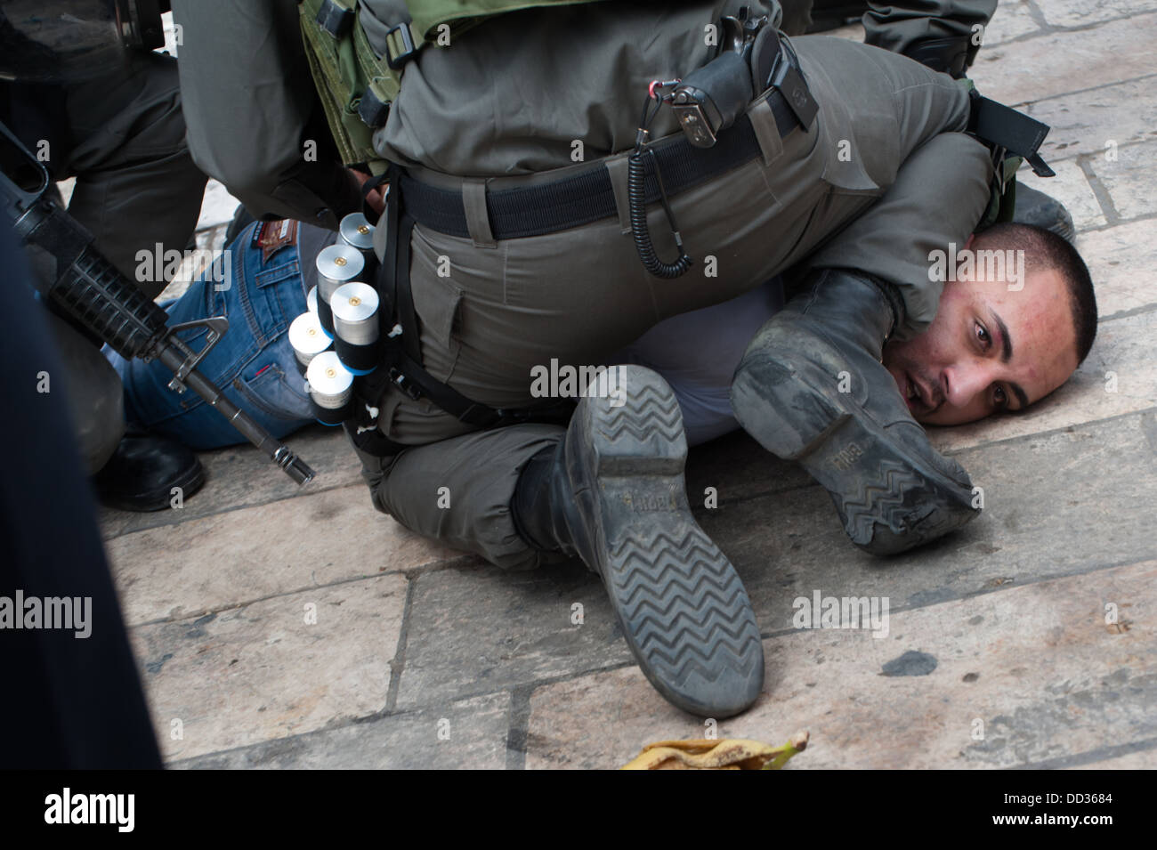 Israeli police arrest a Palestinian man during clashes with Palestinians commemorating Nakba Day at Damascus Gate. - Stock Image