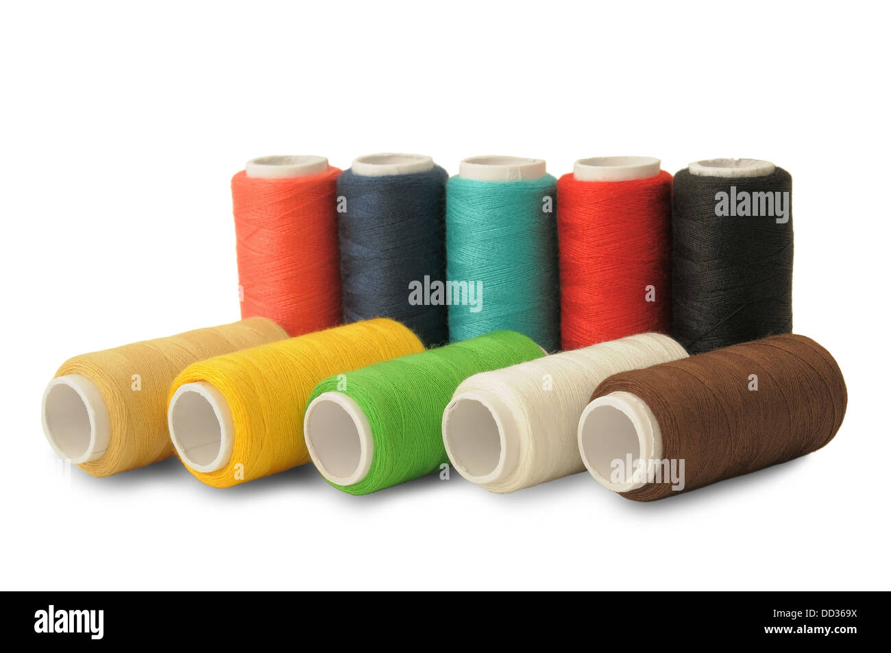 Spools of threads of different colors on white - Stock Image