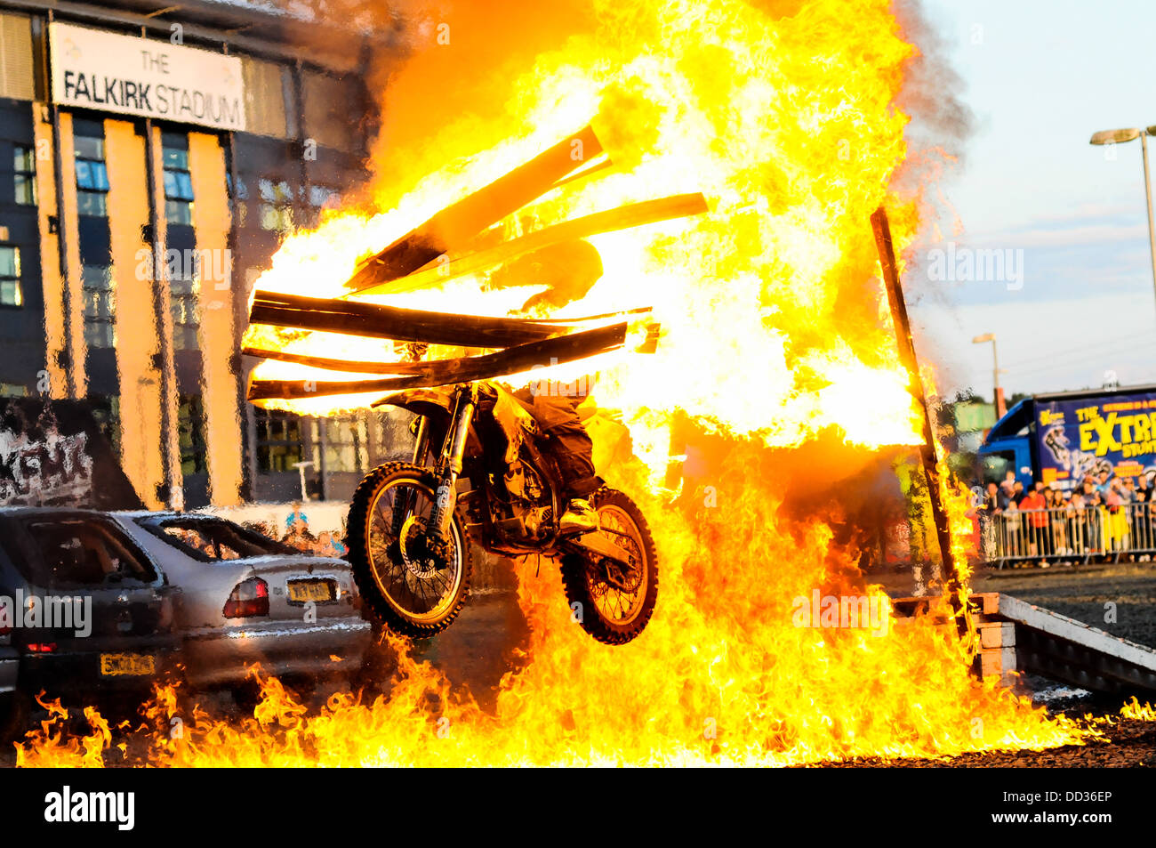 A dirt bike leaps through a wall of fire at the Extreme Stunt Show at Falkirk Stadium. - Stock Image