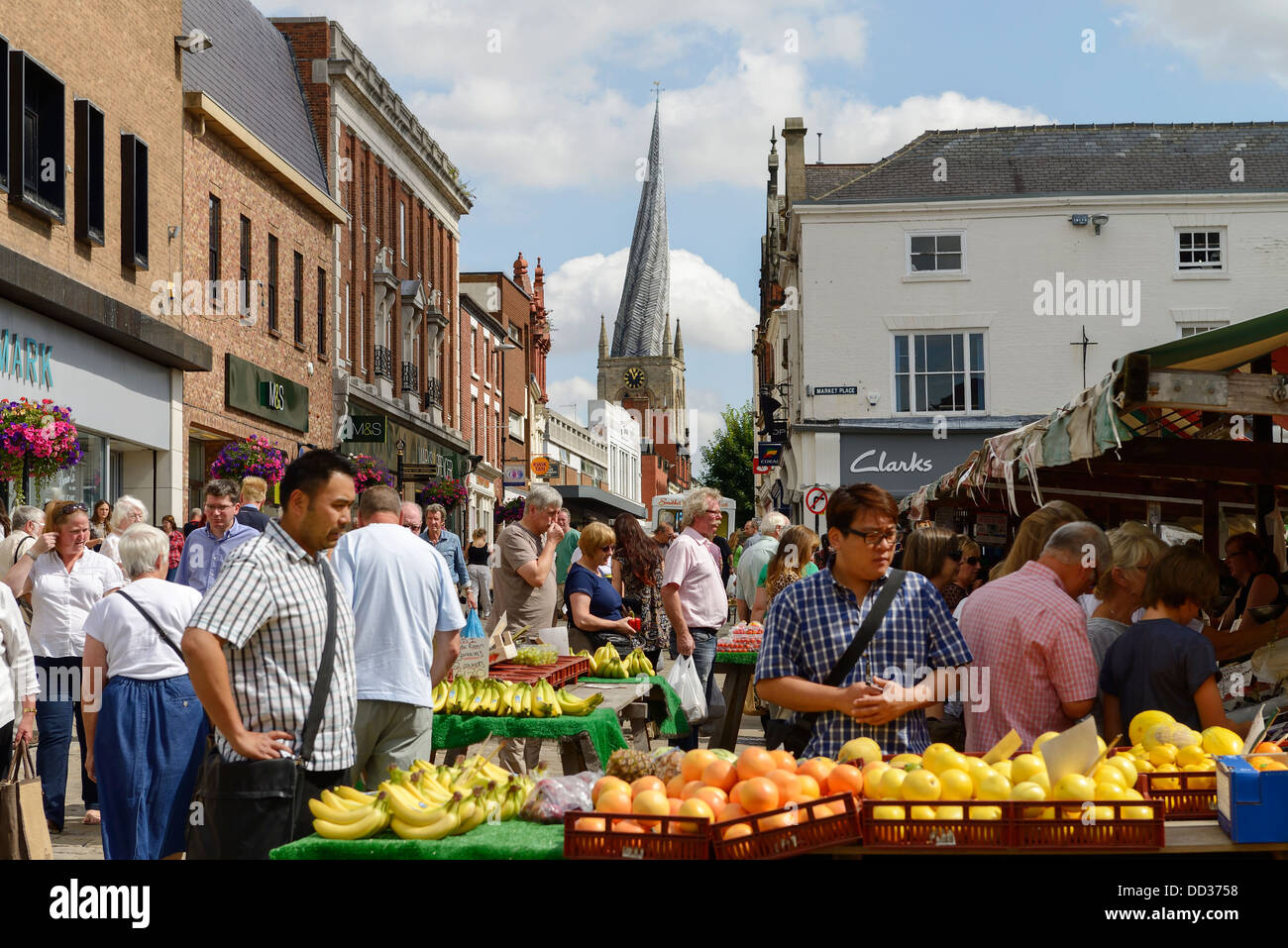 Shoppers visiting the outdoor market in Chesterfield town centre - Stock Image