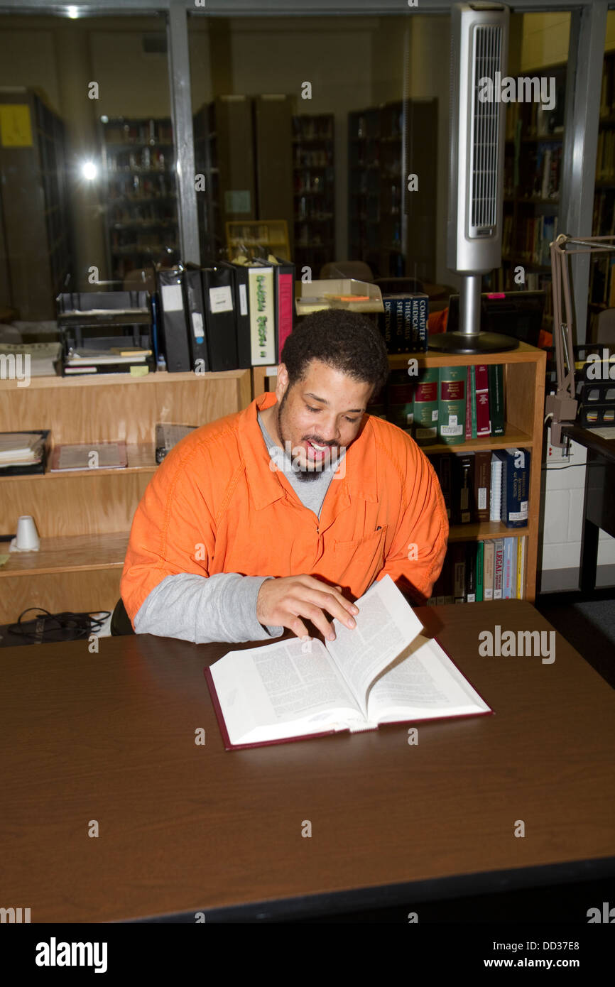 Segregation inmate using library to do some legal work. Lincoln Correctional Center prison in Lincoln, Nebraska. - Stock Image
