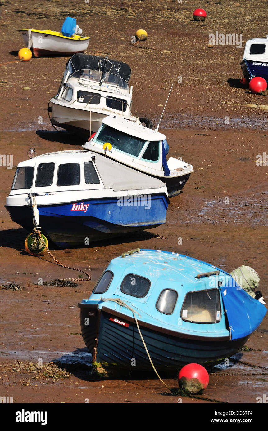 Small cruising boats stranded by low tide in the River Teign Estuary near Shaldon in Devon Stock Photo