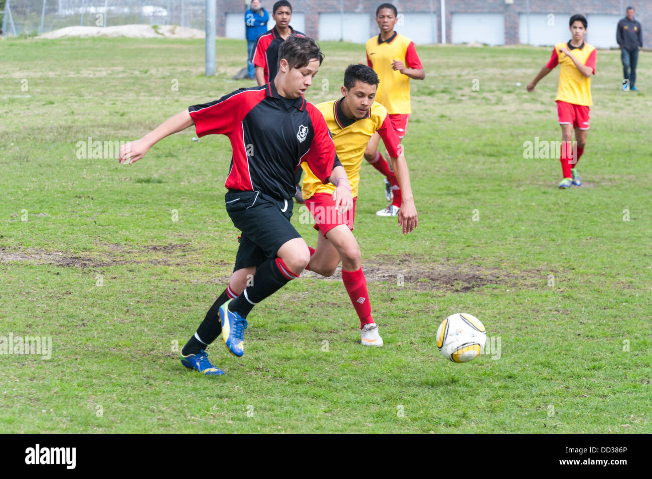 U15B football players in action playing a match Cape Town, South Africa - Stock Image