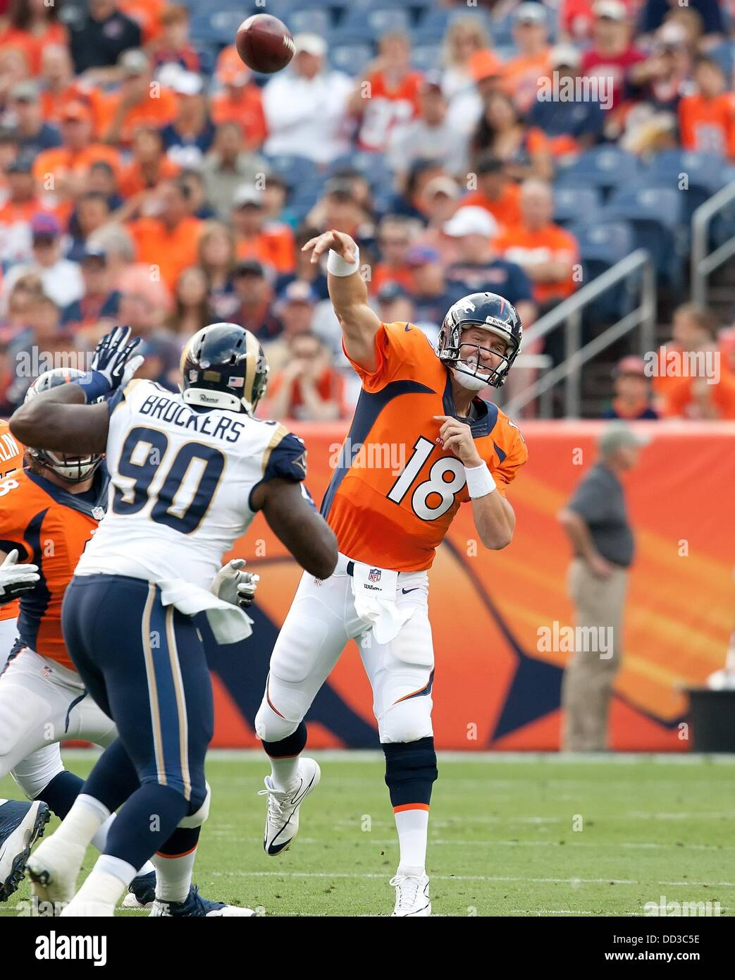 Denver, Colorado, USA. 24th Aug, 2013. Denver Broncos QB PEYTON MANNING airs a pass during the 1st. half at Sports - Stock Image