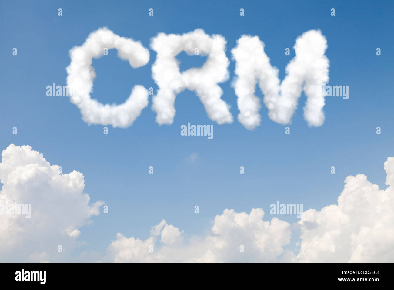 Customer relationship management CRM concept text word in clouds on blue sky - Stock Image